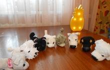 Мягкие игрушки собачек и кошечек