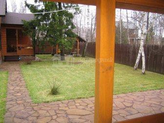 Просмотреть фото Загородные дома Коттедж из клееного бруса на участке 15 соток в окружении леса 29371995 в Москве